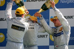 Paul di Resta, Persson Motorsport AMG Mercedes and Bruno Spengler, Team HWA AMG Mercedes, give race winner Mika Hakkinen, Team HWA AMG Mercedes, a champagne shower