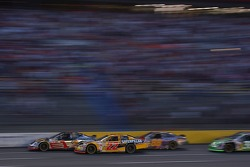 Dave Blaney duels with Martin Truex Jr. and Ricky Rudd