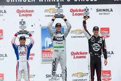 Podium: Race winner Sébastien Bourdais, second place Takuma Sato and third place Graham Rahal