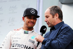 Lewis Hamilton, Mercedes AMG F1 on the podium with Gerhard Berger