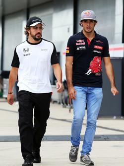 Fernando Alonso, McLaren with Carlos Sainz Jr., Scuderia Toro Rosso