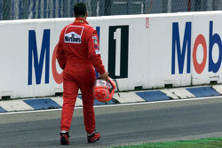 Michael Schumacher, Ferrari returns to the pits after crashing at the start