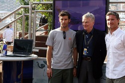 Mark Webber, Red Bull Racing, Max Mosley, FIA President and David Coulthard, Red Bull Racing at the opening of a charity event to give fans the chance to have their picture on the Red Bull Racing F1 Car, at the British Grand Prix- Formula 1 World Champion