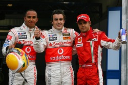 Pole winner Fernando Alonso celebrates with Lewis Hamilton and Felipe Massa