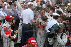 Photographers in the spray of the champagne