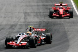 Lewis Hamilton, McLaren Mercedes, MP4-22 and Kimi Raikkonen, Scuderia Ferrari, F2007