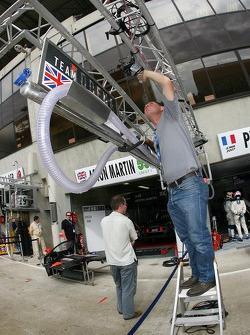 Team Modena team member prepares pit area