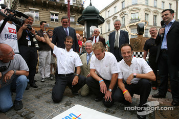 The winners of the 24 Hours of Le Mans 2006 Marco Werner, Frank Biela and Emanuele Pirro get ready to unveil the traditional winners manhole cover in downtown Le Mans