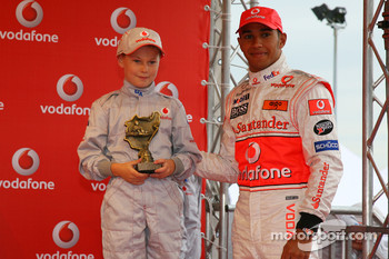 Lewis Hamilton, McLaren Mercedes, with a young karter, Vodafone Karting Event