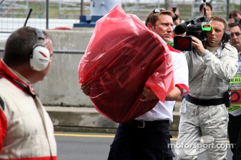 Tyre from the car of Lewis Hamilton, McLaren Mercedes is recovered after crashing heavily
