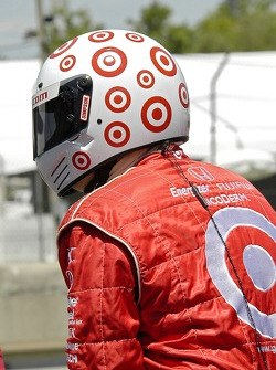 A Target Chip Ganassi Racing crew member watches the action