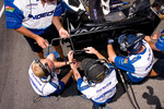 Paul Tracy's crew working on rear wing