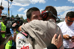 Pole winner Patrick Carpentier celebrates