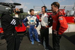 Scott Pruett and Alex Gurney give interviews before the race