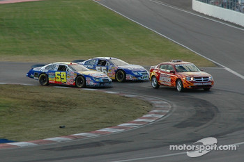 Marcos Ambrose and Robby Gordon battle behind the pace car