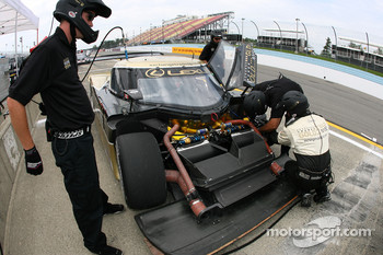 AIM Autosport team members at work