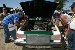 Fans check out a vintage Buick of Darrell Waltrip