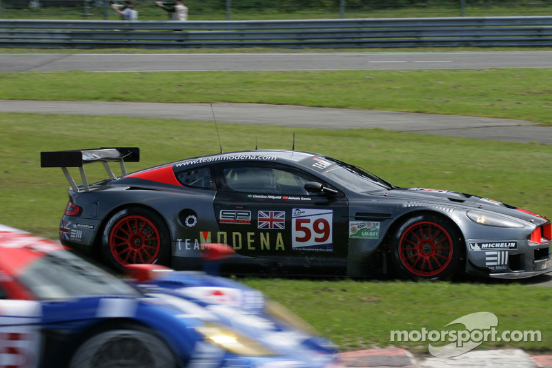 #59 Team Modena Aston Martin DBR9: Antonio Garcia, Christian Fittipaldi is finally pulled off the curb in les Combes by a tractor, and mows grass to rejoin down at least a lap