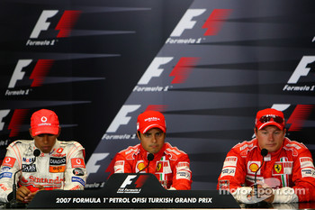 FIA press conference: pole winner Felipe Massa celebrates with Lewis Hamilton and Kimi Raikkonen