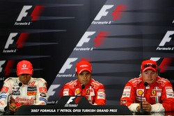 FIA press conference: pole winner Felipe Massa celebrates with Lewis Hamilton and Kimi Raikkonen