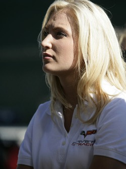 A lovely Corvette Racing team member watches the qualifying session