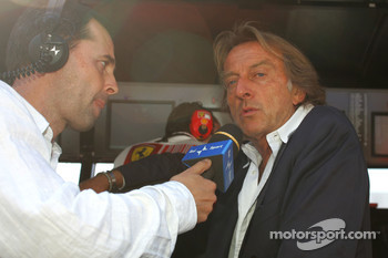 Luca di Montezemolo, Scuderia Ferrari, FIAT Chairman and President of Ferrari on the pitwall with TV