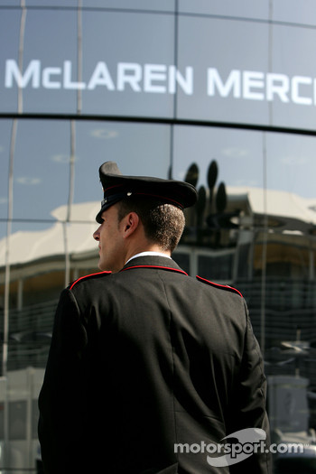 A police officer outside McLaren Mercedes