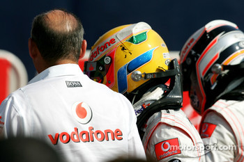 Race winner Fernando Alonso celebrates with Lewis Hamilton and Ron Dennis