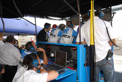 TELMEX Chip Ganassi with Felix Sabates team members monitor the qualifying action