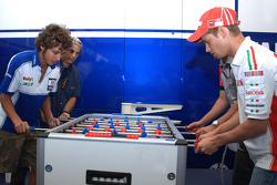 Casey Stoner and Valentino Rossi fight to the foosball death