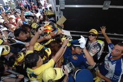 Valentino Rossi makes his way through the fans