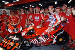 2007 MotoGP champion Casey Stoner celebrates with his team
