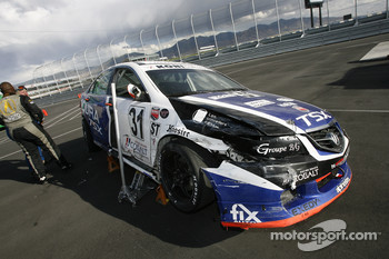 #31 i-MOTO Racing Acura TSX sits on pitlane with major damage