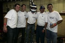Race winner Bryce Miller and Andy Lally celebrate with co-drivers friends