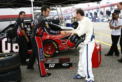 Sam Hornish Jr. and Jacques Villeneuve shake hands
