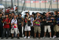 Photographers wait for Parc Ferme