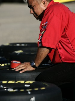 A crew member prepares Good Year tires