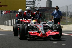 Lewis Hamilton, McLaren Mercedes, MP4-22 is pushed back to Parc Ferme