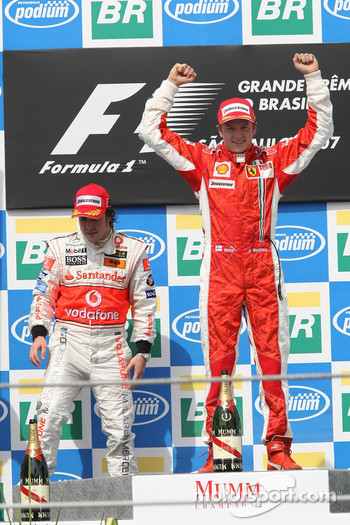 Podium: race winner and 2007 World Champion Kimi Raikkonen and third place Fernando Alonso