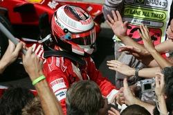 Race winner and 2007 World Champion Kimi Raikkonen celebrates with his team