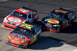 Jeff Gordon leads Reed Sorenson and Martin Truex Jr.