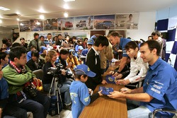 Petter Solberg and Xavier Pons sign autographs