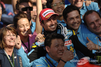 Third place John Hopkins celebrates with Rizla+ Suzuki team members
