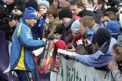 Petter Solberg signs autographs