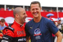Tony Kanaan and Michael Schumacher
