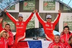 Podium: 2007 World Rally Champions Sébastien Loeb and Daniel Elena celebrate with Citroen Total WRT team members