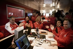 Citroen Total WRT team members celebrate as Sébastien Loeb clinches the 2007 World Rally Championship