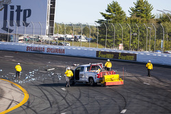 Track crew cleans up the track