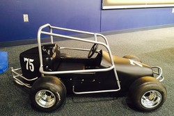 Jeff Gordon is given a replica of his quarter midget