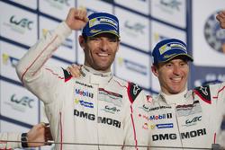 Podium: race winners Timo Bernhard with Mark Webber, Porsche Team